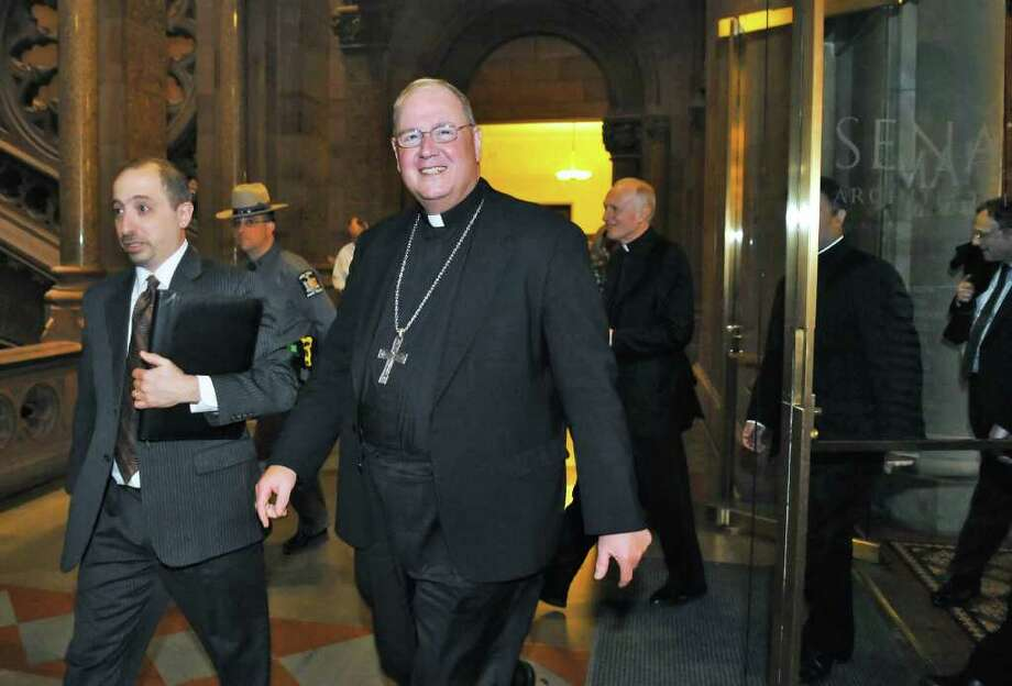 Archbishop Timothy M. Dolan of New York (center) makes his way through tie state Capitol in Albany Tuesday afternoom Mar. 8, 2011.  (John Carl D'Annibale / Times Union) Photo: John Carl D'Annibale / 00012309A