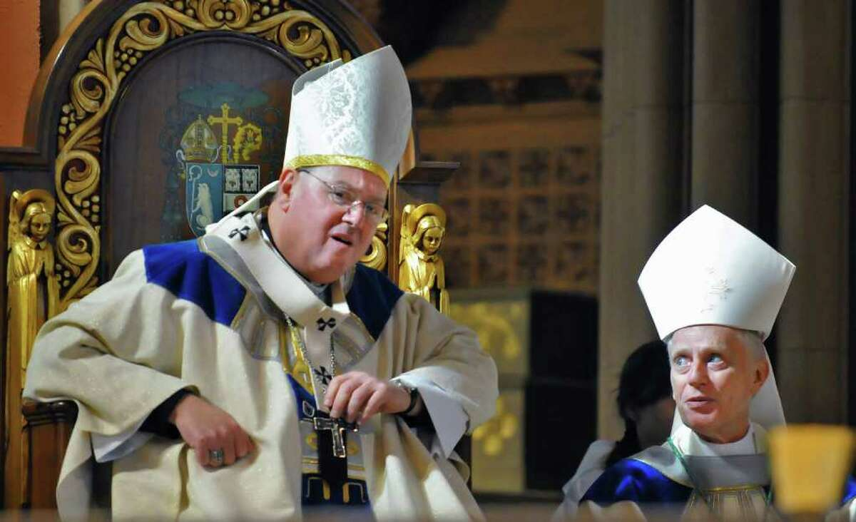 Archbishop Timothy M. Dolan of New York, left, and Bishop Howard J. Hubbard of Albany during a Mass with other NYS Bishops at the Cathedral of the Immaculate Conception in Albany Tuesday morning March 8, 2011. (John Carl D'Annibale / Times Union)