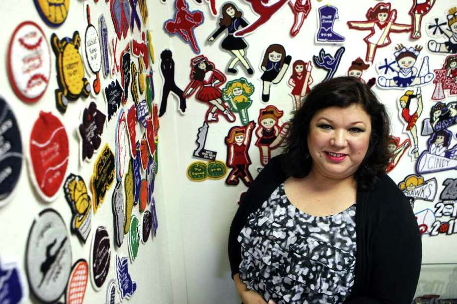 CONEXION: Rose Mary Bueno is the owner of Some Things to Cheer About, a local cheerleading specialty store on the city's North Side.  HELEN L. MONTOYA/hmontoya@conexionsa.com Photo: HELEN L. MONTOYA, San Antonio Express-News / hmontoya@express-news.net