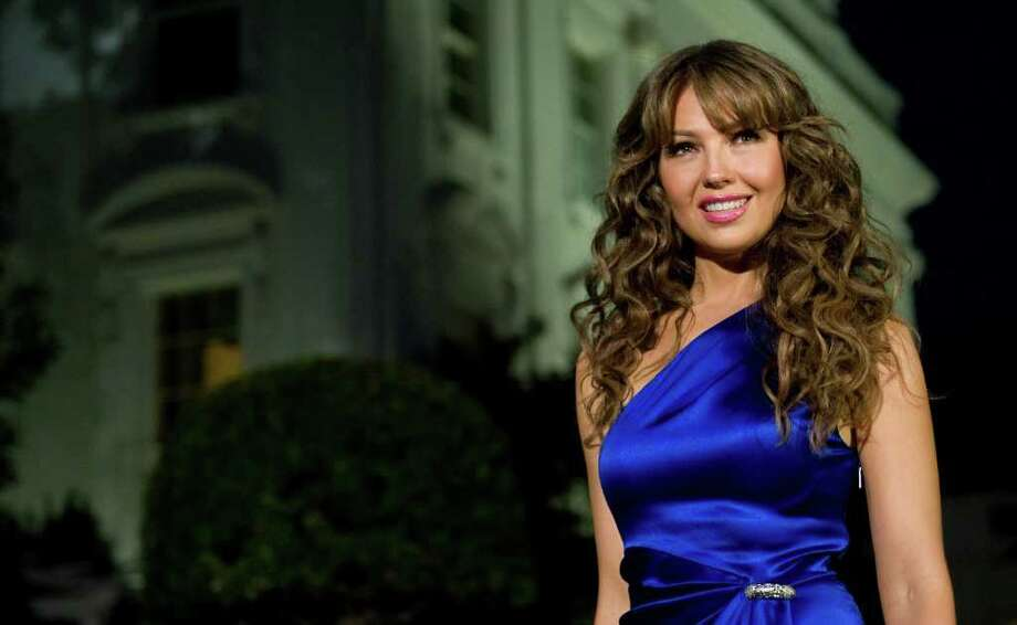 "Thalía arrives for a taping of ""In Performance at the White House: Fiesta Latina,"" a concert hosted by US President Barack Obama celebrating Hispanic musical heritage, on the South Lawn of the White House in Washington, DC, on October 13, 2009. Televised on October 15th on public broadcasting stations nationwide, participants also include Gloria Estefan, George Lopez, Jimmy Smits, Tito ""El Bambino"", the Bachata music group Aventura, and the Chicano rock band Los Lobos. AFP PHOTO / Saul LOEB Photo: SAUL LOEB, AFP/Getty Images / 2009 AFP"