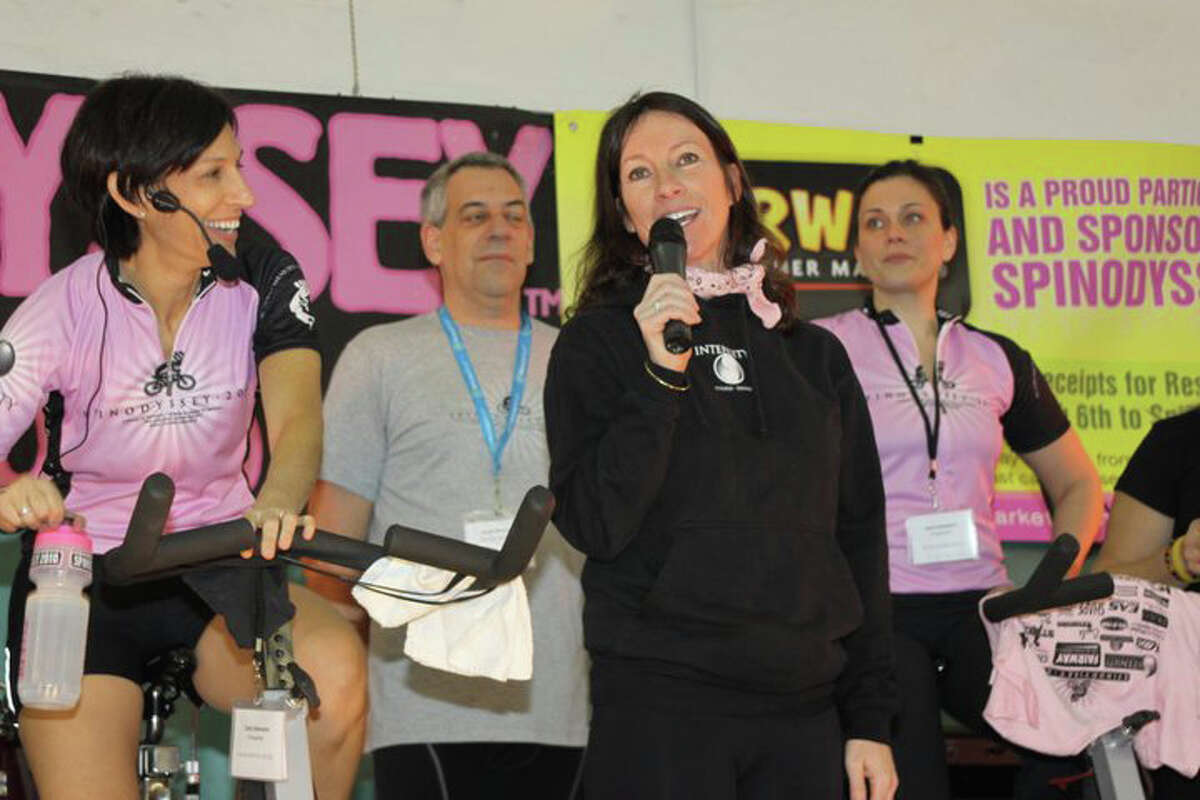 Clair Mason, co-owner of INTENSITY, welcomes the crowd.