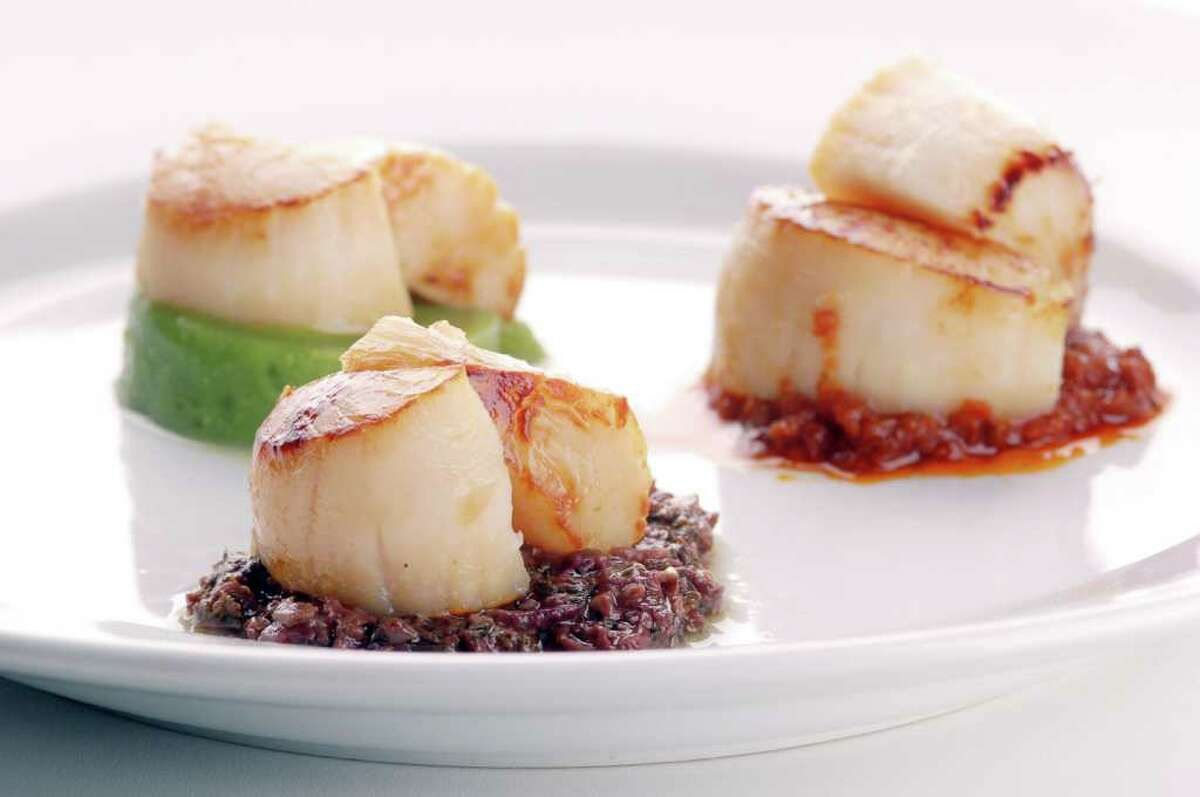 Scallops with three sauces.