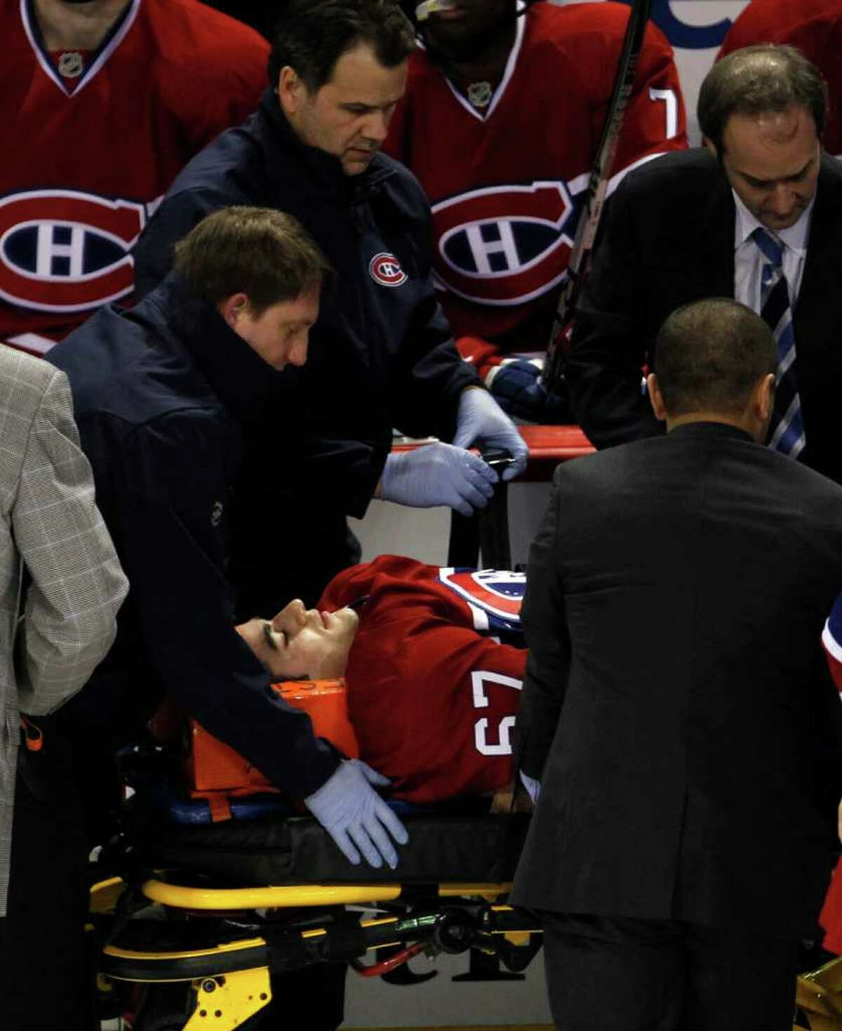 Montreal Canadiens' Max Pacioretty is wheeled away on a stretcher after taking a hit by Boston Bruins' Zdeno Chara during the second period of an NHL hockey game, Tuesday, March 8, 2011, in Montreal.