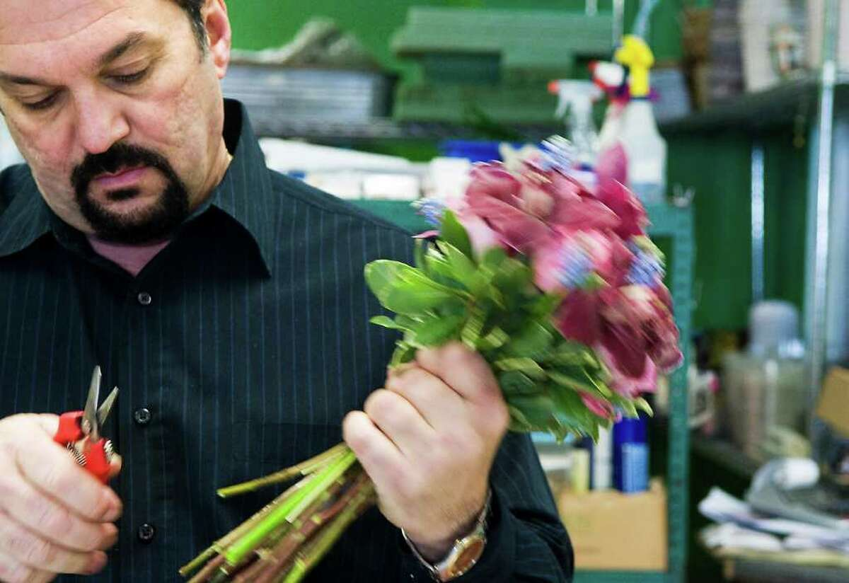 Teddy Gianokos, President of Peter's Wholesale Florist, works on wedding bouquets at his location in Stamford, Conn. on Wednesday March 9, 2011.