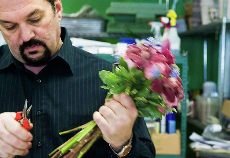 Teddy Gianokos, President of Peter's Wholesale Florist, works on wedding bouquets at his location in Stamford, Conn. on Wednesday March 9, 2011. Photo: Kathleen O'Rourke / Stamford Advocate