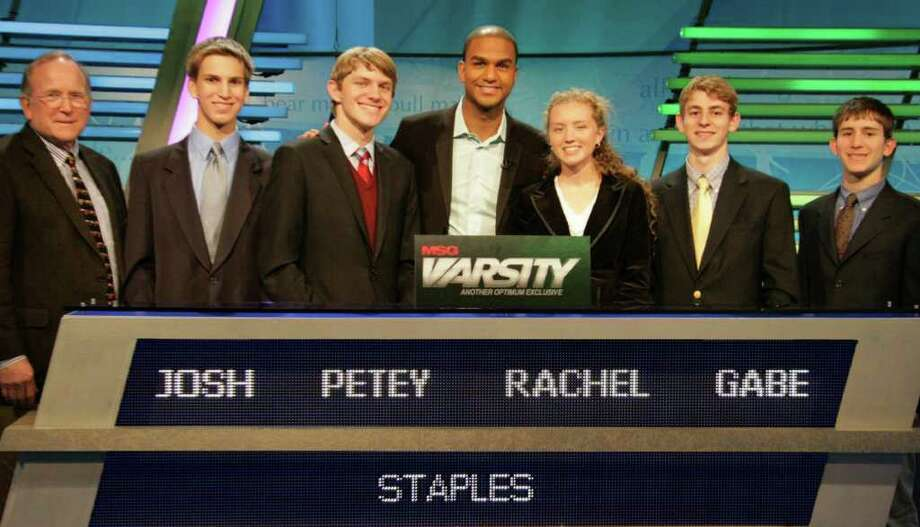 "The Staples High School on the set of the MSG Varsity cable television show, ""The Challenge,"" where the Westport team's second-round match will be broadcast March 29. They are, from left: Jim Goodrich, academic advisor; Joshua Greenberg, Petey Menz, team captain; host Jared Cotter, Rachel Myers, Gabriel Block and Matthew Silver. Photo: Contributed Photo / Westport News contributed"
