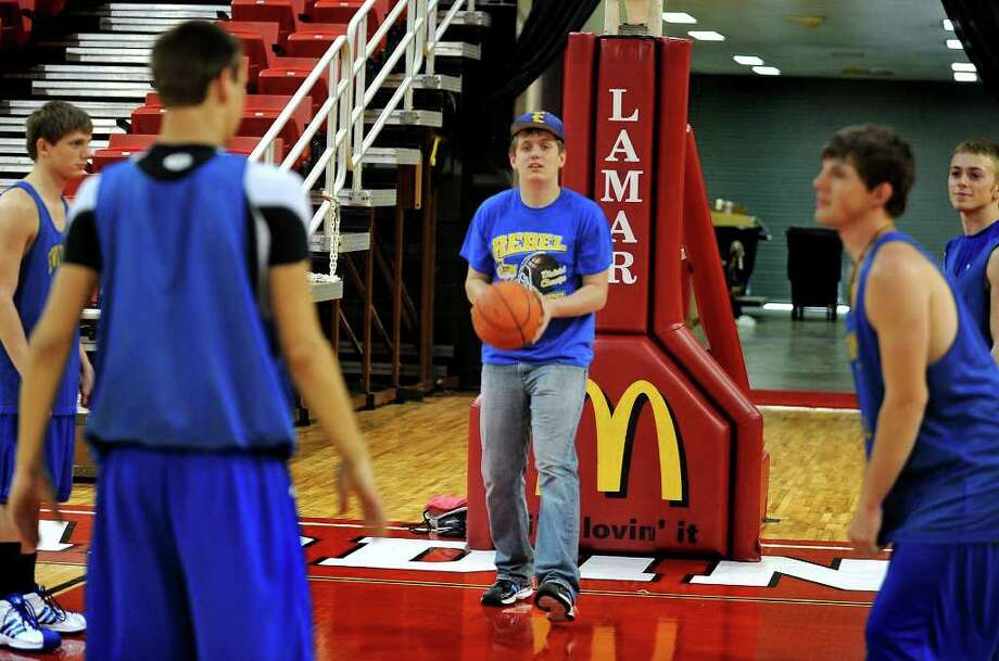Evadale's Daniel Linscomb helps the Rebel team practice for Thursday's finals game.  Guiseppe Barranco/The Enterprise / Beaumont
