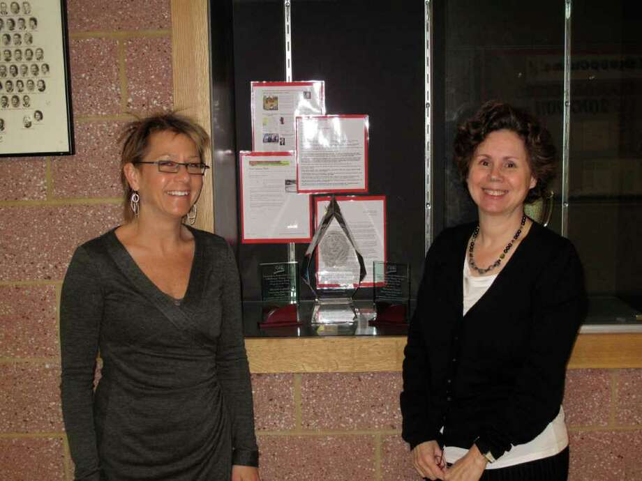 Michelle Luhtala and Christina Russo stand proudly with the NCHS Library Media Center's award. Photo: Contributed Photo;Paresh Jha Staff Photo, Contributed Photo / New Canaan News