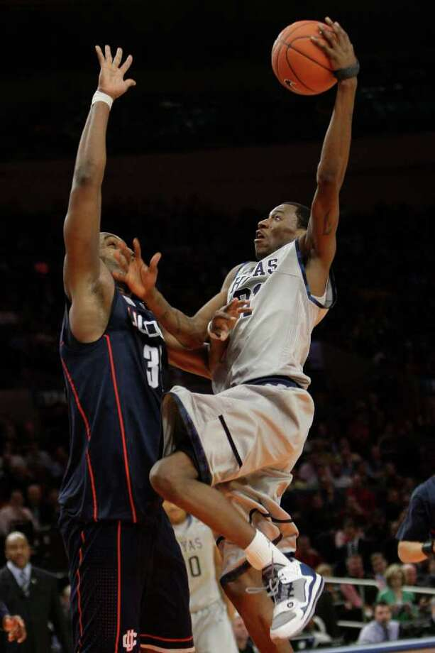 Georgetown's Jason Clark goes to the basket against Connecticut's Charles Okwandu during the second half of an NCAA college basketball game at the Big East Championship, Wednesday, March 9, 2011 at Madison Square Garden in New York. Connecticut defeated Georgetown 79-62. (AP Photo/Mary Altaffer) Photo: AP
