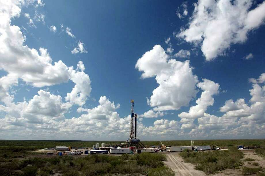 A drilling site owned by Petrohawk Energy Corp. at the Eagle Ford Shale. Photo: Jake Lacey, HOUSTON CHRONICLE / Jake Lacey