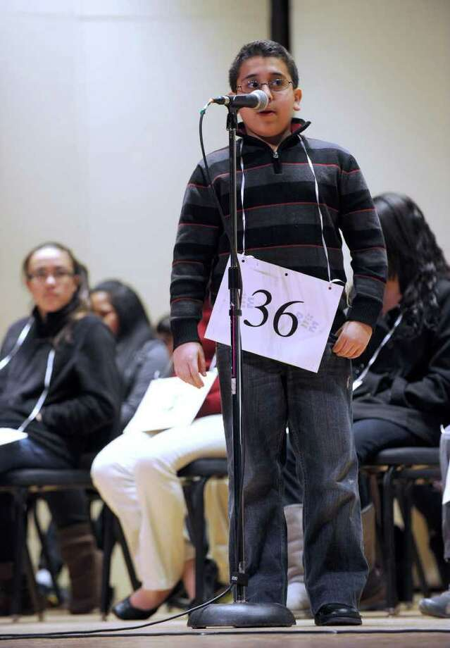 Abram Mikhaeel, 10, of Bridgeport, spells a word during the spelling bee. Photo: Carol Kaliff / The News-Times