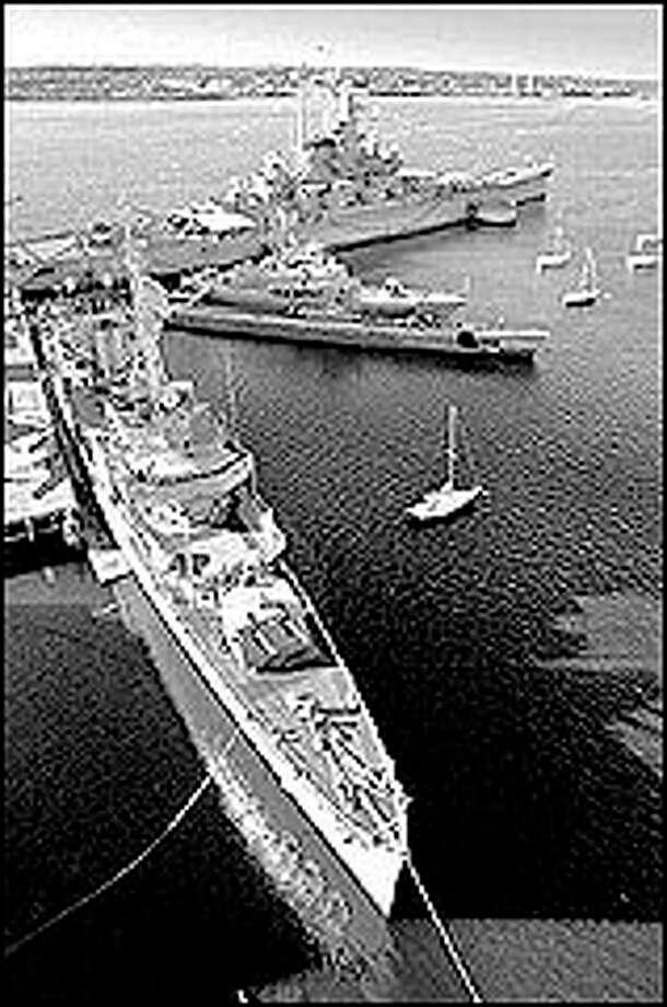 An overview of the national historic landmark Battleship Cove shows the USS Joseph P. Kennedy, foreground, the submarine USS Lionfish, a former East German missile ship and the USS Massachusetts. Photo: AP Photo
