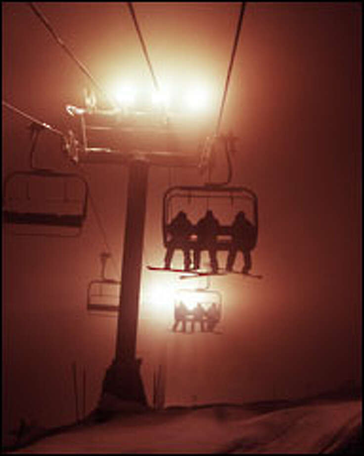 Skiers head up the mountain on the quad lift at Summit Central. Photo: Meryl Schenker