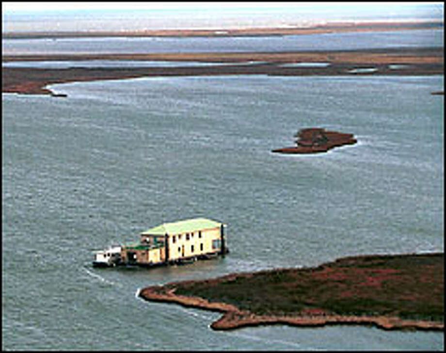 The Beau Rivage Sportsman's Lodge, built on a barge, is a 5,000-square-foot floating resort. Photo: Judi Botton/AP