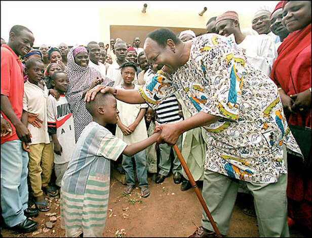 Gen. Yakubu Gowon, a former Nigerian head of state, visits villagers in Lafia. Gowon now works to improve water quality. Photo: Mike Urban/Seattle Post-Intelligencer
