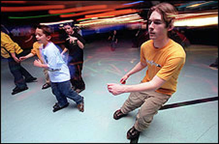On a recent Friday night the Skate King in Bellevue is swirling with youthful energy as several hundred adolescents roll out. Today's roller rinks offer something for everyone, including speed skating, artistic skating, tiny-tot lessons, Christian music nights, adult hip-hop nights and roller fitness. Photo: Grant M. Haller/P-I Photos