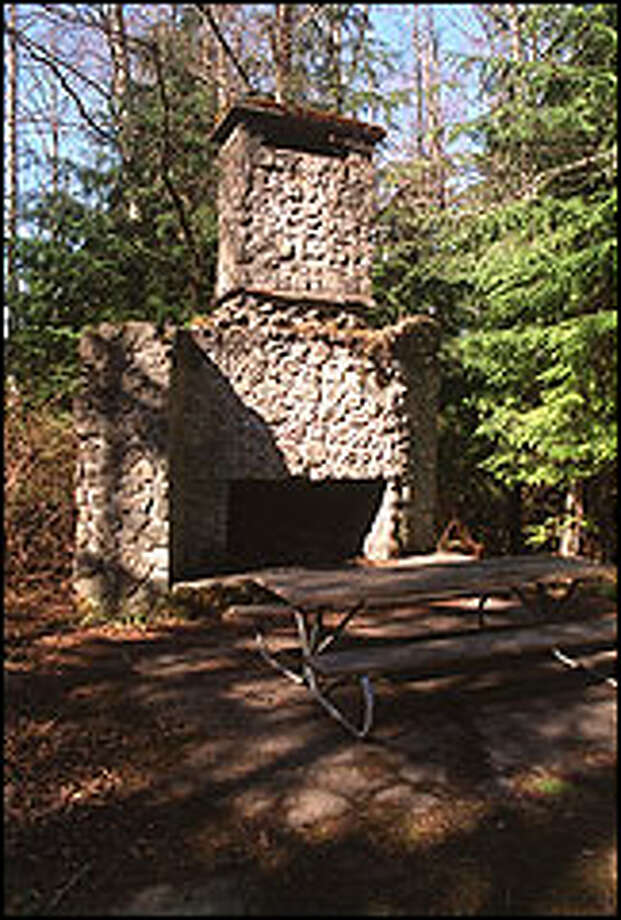 The fireplace and chimney are all that remain of the old Bullitt family homestead on Squak Mountain, now an excellent trailside picnic spot. Photo: Karen Sykes