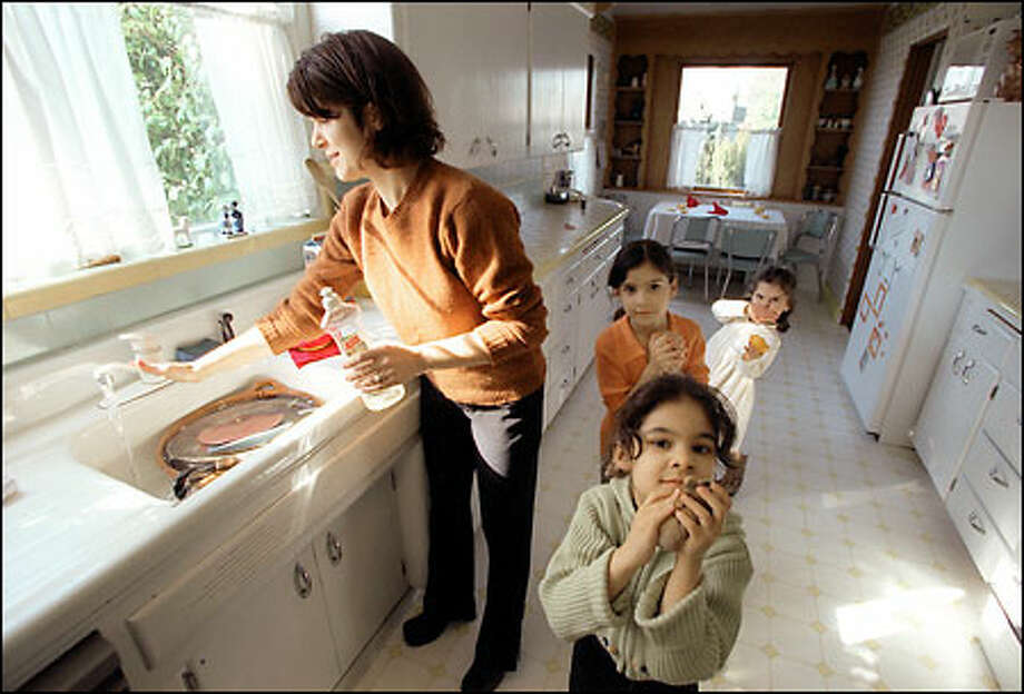 Molly Alvarado and her daughters Marcella, 6, Amalia, 7, and Isabella, 4, face the loss of their home since Pedro Alvarado was deported to Mexico. Photo: Gilbert W. Arias/Seattle Post-Intelligencer