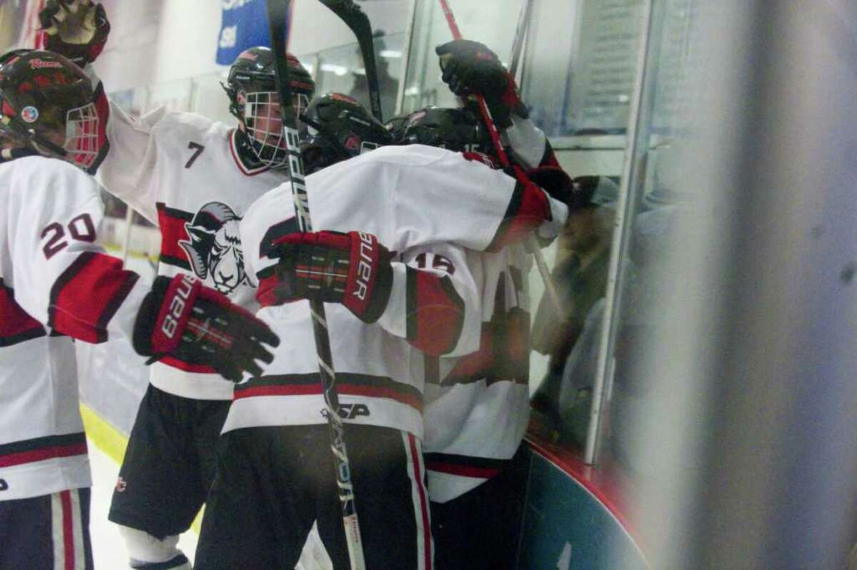 The Rams celebrate their first goal which was quickly followed by two more in the final minutes of the second period as New Canaan faces Greenwich in a boys hockey game at the Darien Ice Rink in Darien, Conn., March 9, 2011.