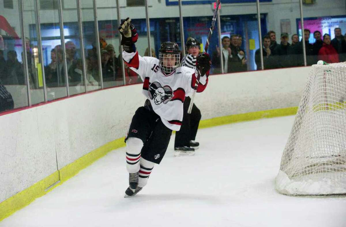 New Canaan's Dylan Hart reacts to his goal as New Canaan faces Greenwich in a boys hockey game at the Darien Ice Rink in Darien, Conn., March 9, 2011.