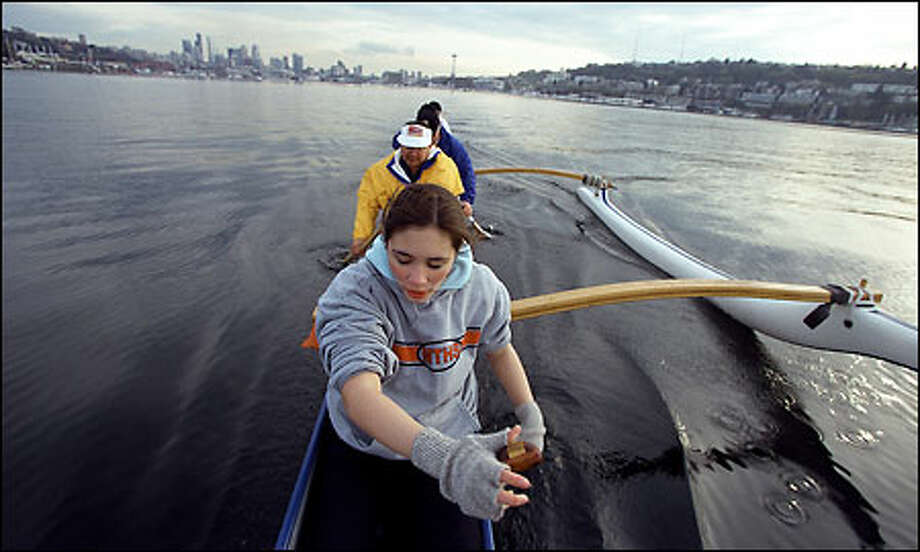 """Members of the Hawaiian Outrigger Club """"Hui Wa'ao Wakinikona"""" paddle on Lake Union during a recent workout. In front is 16-year-old Keola Awana. Photo: Gilbert W. Arias/Seattle Post-Intelligencer"""