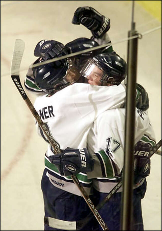 Tim Preston (17) is embraced by Thunderbirds teammates after his first-period goal gave Seattle a 2-0 lead against the West division champion Kelowna Rockets. Photo: Mike Urban/Seattle Post-Intelligencer