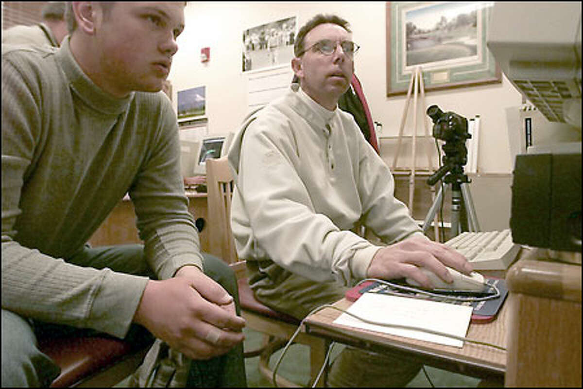 Tom Sovay, right, reviews Pete Cowie's swing on a computer program at Harbour Pointe Golf Club in Mukilteo. Sovay, who charges $60 for a 45-minute session, has a client list of 1,000 golfers.