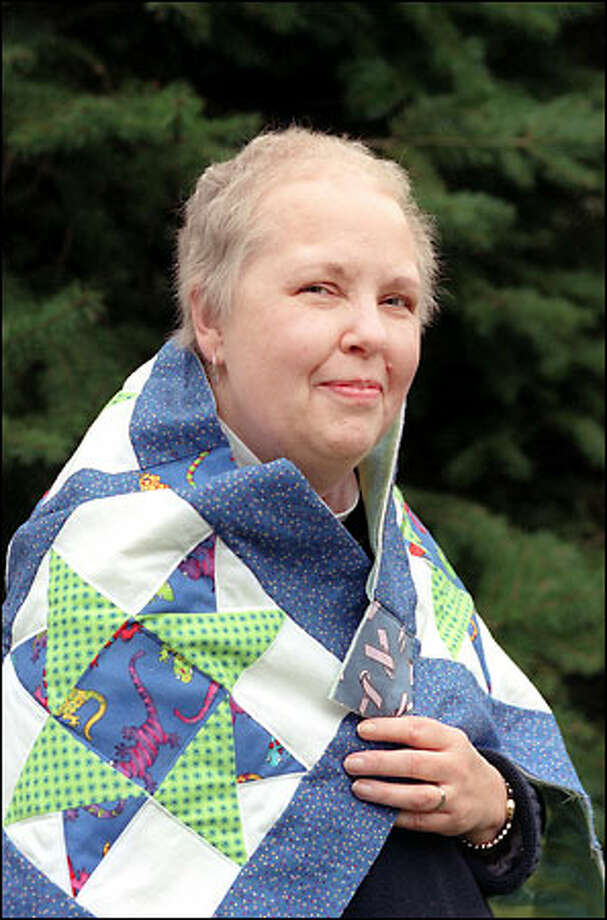 Despite battling breast cancer since 1996, Bonnie DeSpain has made nearly 300 lap quilts and given them to other cancer patients. DeSpain lives in Bellingham. Photo: Meryl Schenker/Seattle Post-Intelligencer