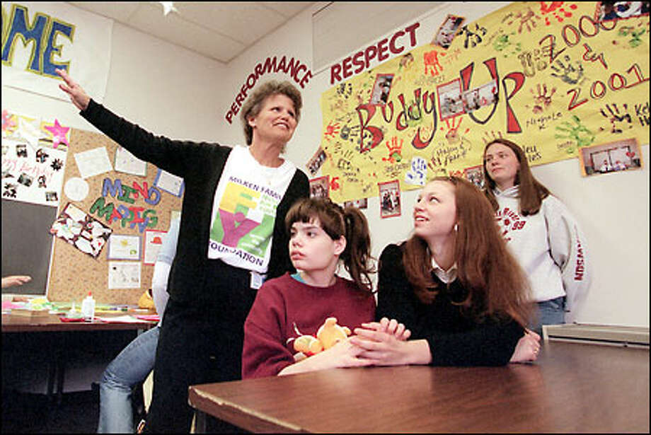 White River High School teacher Dianne Campbell teaches her psychology class, which is mixed with an adaptive special education class. Students Holly Davidson, left, and Kim Edwards use time in class to get to know each other and develop their friendship. Photo: Meryl Schenker/Seattle Post-Intelligencer
