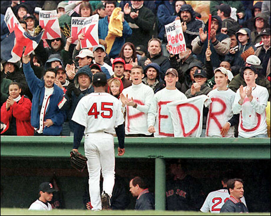 Boston ace Pedro Martinez is cheered by Fenway Park fans as he strolls back to the dugout after striking out the side in the first. Photo: / Associated Press