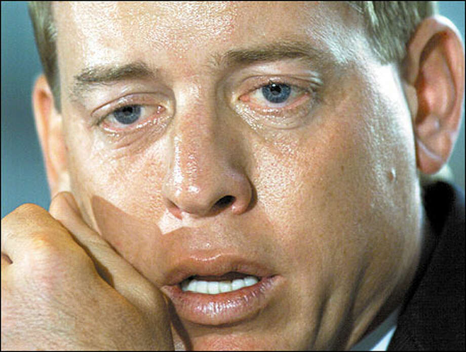 Former Dallas Cowboy quarterback Troy Aikman pauses during a news conference where he announced his retirement from the NFL in Irving, Texas. Aikman was waived by the Cowboys on March 7, a day before he was due a $7 million bonus and seven-year contract extension. Photo: / Associated Press