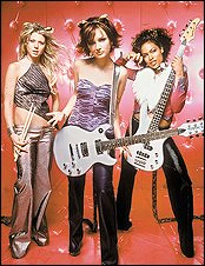 """Small-town musicians aim for the stars in """"Josie and the Pussycats,"""" starring, from left, Tara Reid, Leigh Cool and Rosario Dawson. Photo: Universal Pictures / UNIVERSAL PICTURES"""