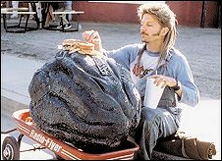 David Spade plays a big-hearted 'redneck' in Adam Sandler's 'Joe Dirt.'