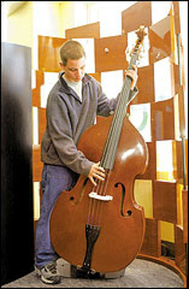 Soundbridge, the Seattle Symphony Orchestra's new learning center, gives people the chance to play different instruments, including the bass.