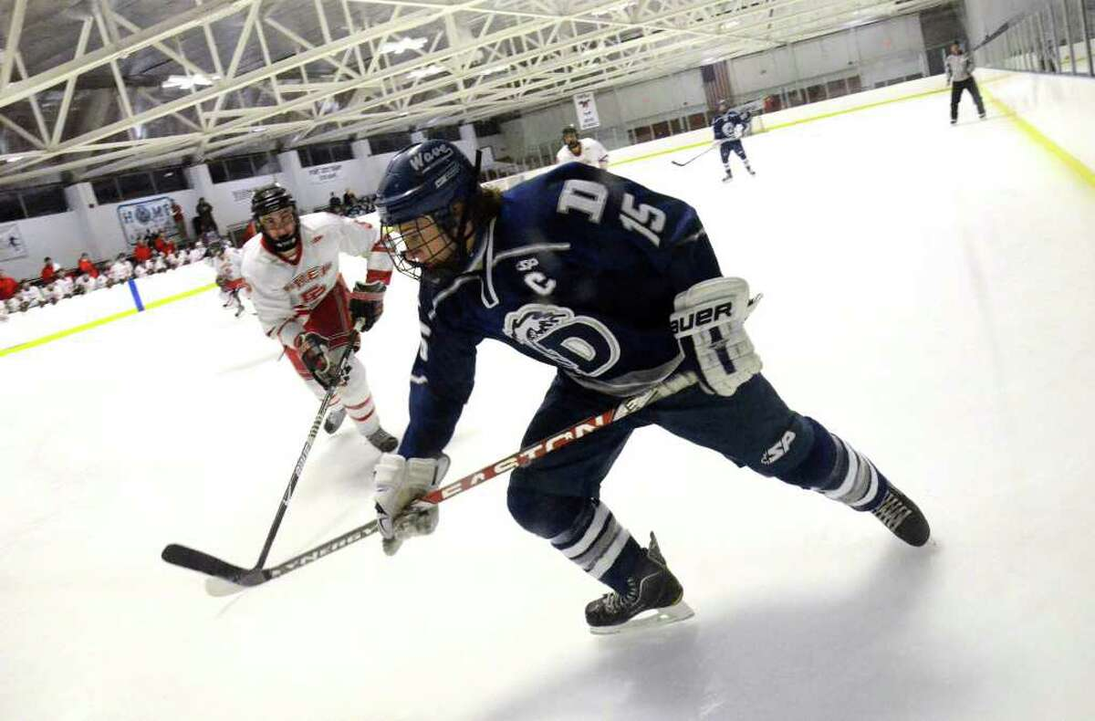 Darien's Nick Bruno (15) skates to the net moments before scoring a goal during the Division I First Round boys ice hockey state tournament against Fairfield Prep at the Wonderland of Ice in Bridgeport on Wednesday, Mar. 9, 2011.