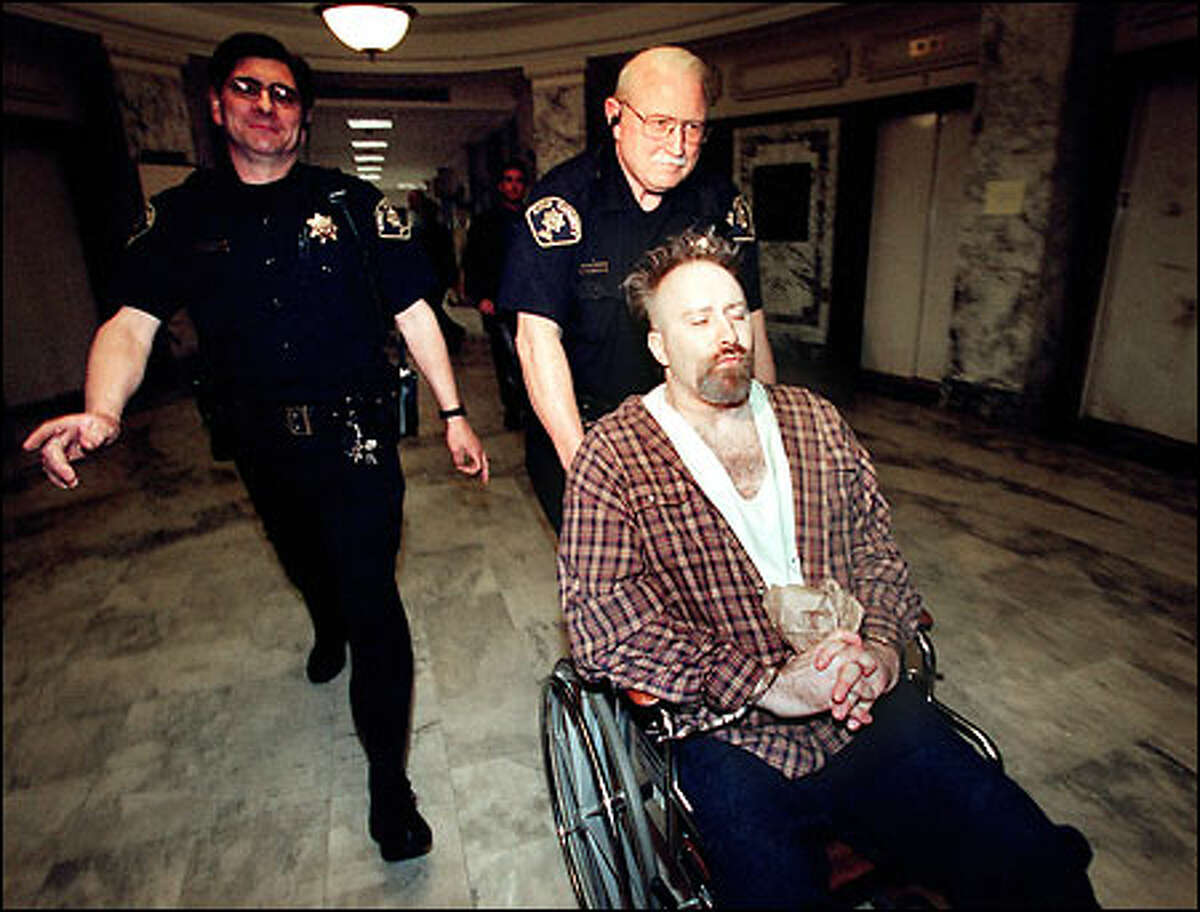 Dayva Cross of Snoqualmie is led into a King County courtroom. A jury must decide whether to give Cross, 41, life in prison or the death penalty for the 1999 stabbing deaths of his wife and two stepdaughters.