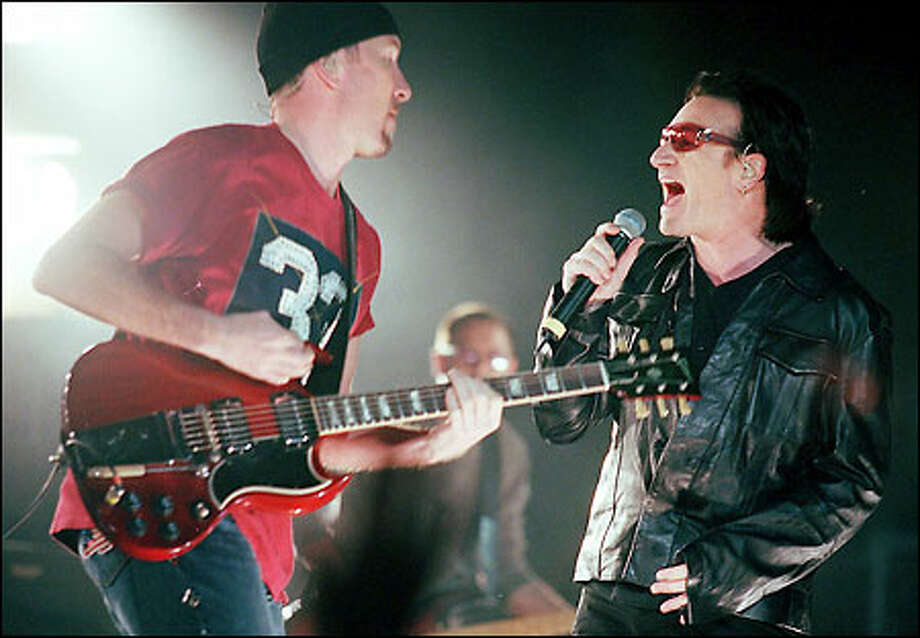 U2's lead guitar The Edge and singer Bono power into their set at the Tacoma Dome. Photo: Paul Joseph Brown/Seattle Post-Intelligencer