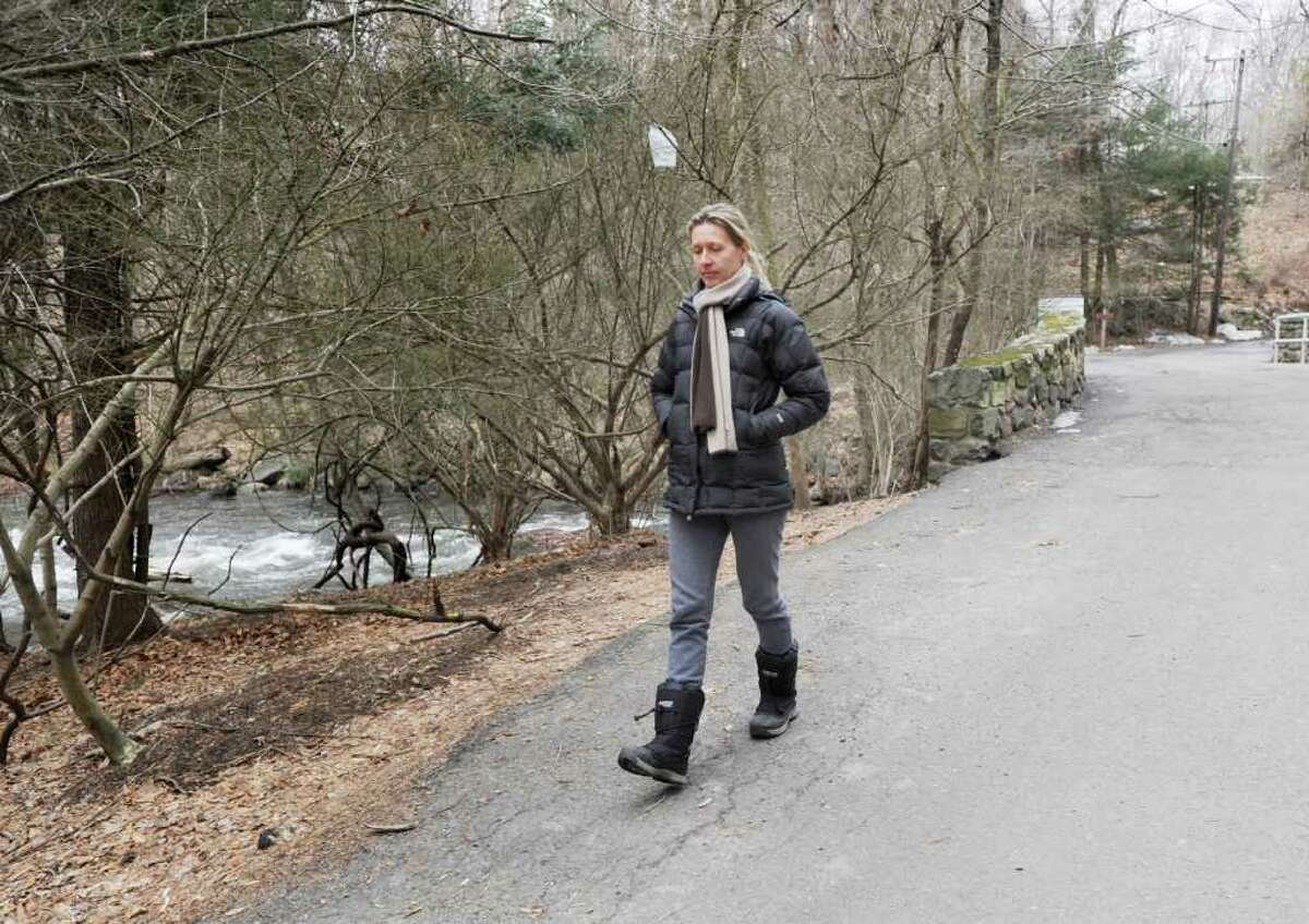 Marcela Krejsova of Stamford walks on Merriebrook Lane in the Stamford section of Mianus River Park, Wednesday afternoon, March 9, 2011. Krejdova's dog, Diesel, a black Labrador retriever mix, went missing in the Stamford section of the park near Greenwich on Sunday, March 6, when he got off his leash to chase a group of deer.