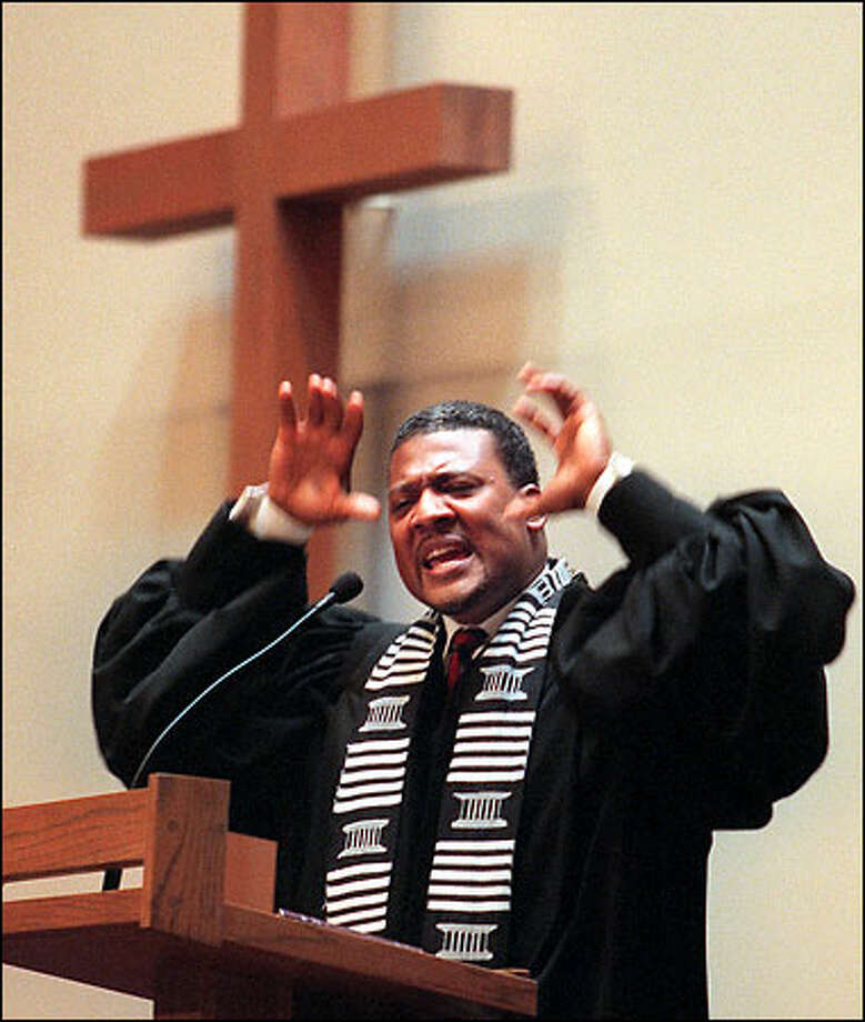 "The Rev. Leslie Braxton of Mount Zion Baptist Church delivers the first of seven impassioned mini-sermons by area pastors on the subject of Jesus' ""Seven Last Words."" Braxton's text was from Luke 23:34; ""Father, forgive them; for they know not what they do."" Photo: Paul Joseph Brown/Seattle Post-Intelligencer"