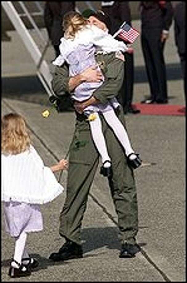 Josef Edmunds  from Davis,California greets his family as VQ-1 Air Reconnaissance. Photo:  Paul Kitagaki Jr./Seattle Post-Intelligencer