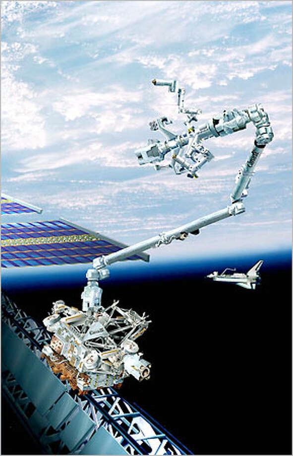 This is an artist drawing of the next-generation Canadian robotic arm which is ready for its flight to the International space station in April 2001. It is the most visibly high-tech, sci-fi piece of the space station jugsaw puzzle to date: a billion dollar construction crane that has a hand on each end and capable of walking across the orbiting complex, end over end, in inchwormlike fashion. Photo: / Associated Press