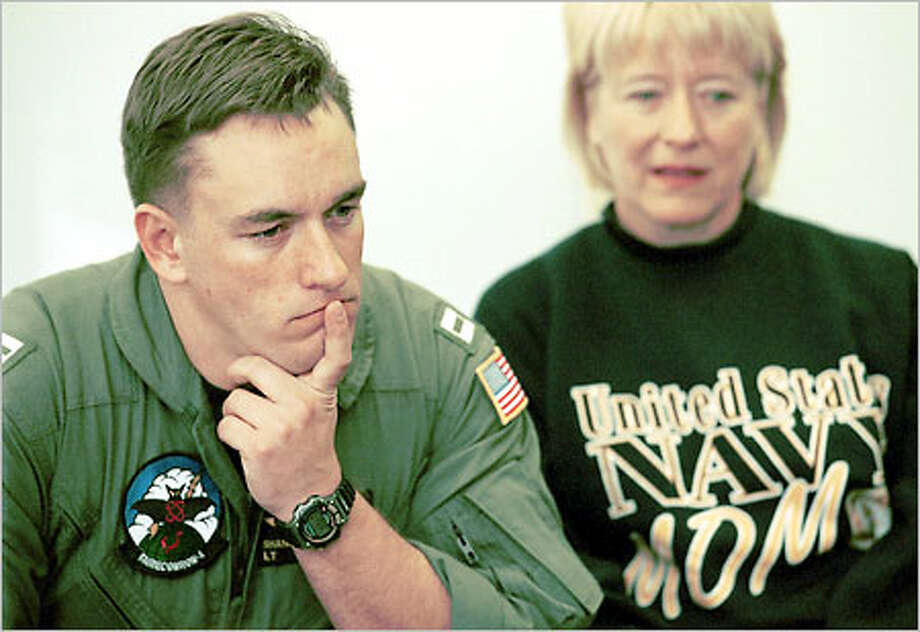 Pilot Lt. Shane Osborn pauses before responding to a question during a news conference in Oak Harbor. His mother, Diane Osborn, sits beside him. Photo: / Associated Press