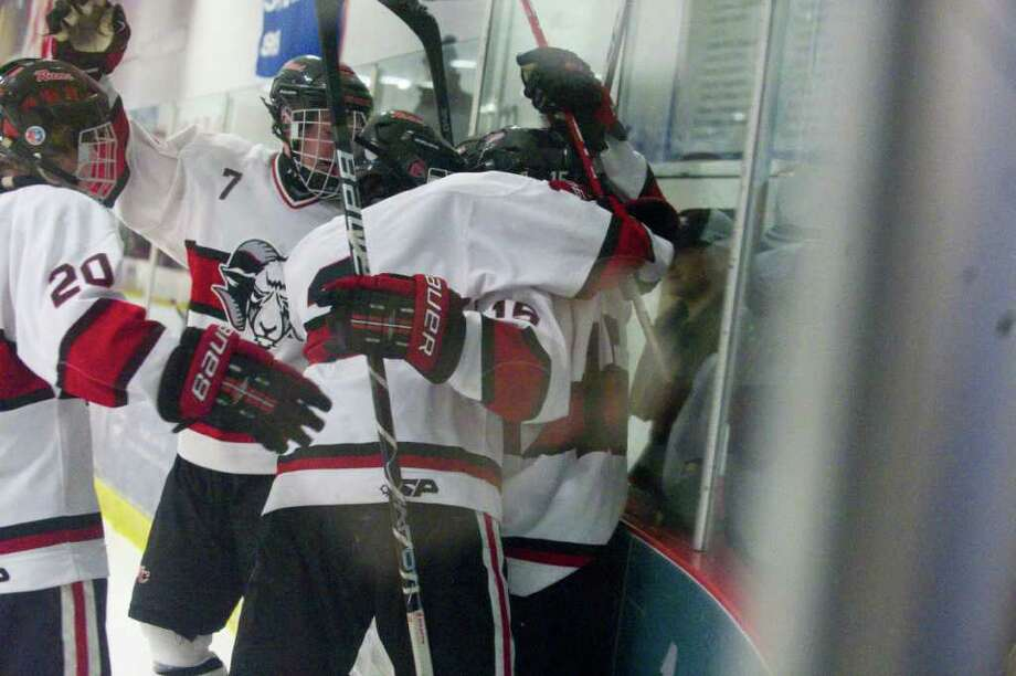 The Rams celebrate their first goal which was quickly followed by two more in the final minutes of the second period as New Canaan faces Greenwich in a boys hockey game at the Darien Ice Rink in Darien, Conn., March 9, 2011. Photo: Keelin Daly / Stamford Advocate