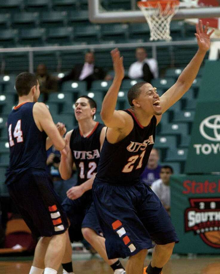 University of Texas San Antonio guard Devin Gibson (right) celebrates along with teammates Alex Vouyoukas (left) and Jeromie Hill (center) after the Roadrunners defeated the Northwestern State Demons 97-96 during the men's opener of the Southland Basketball Tournament at the Merrell Center Wednesday, March 9, 2011, in Katy. Gibson had 28 points in 35 minutes of play. Photo: Cody Duty, Houston Chronicle / Houston Chronicle
