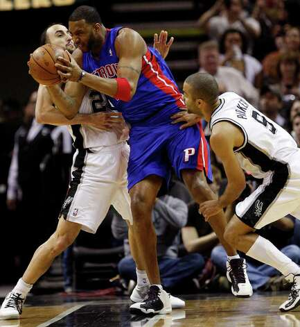 SPURS -- San Antonio Spurs Manu Ginobili, left, and Tony Parker tie up Detroit Pistons Tracy McGrady in the first half at the AT&T Center, Wednesday, March 9, 2011. JERRY LARA/glara@express-news.net Photo: JERRY LARA, San Antonio Express-News / SAN ANTONIO EXPRESS-NEWS (NFS)