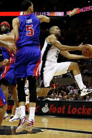 SPURS -- San Antonio Spurs Tony Parker blows by Detroit Pistons Richard Hamilton, left, and Austin Daye in the second half at the AT&T Center, Wednesday, March 9, 2011. The Spurs won 111-104. JERRY LARA/glara@express-news.net Photo: JERRY LARA, San Antonio Express-News / SAN ANTONIO EXPRESS-NEWS (NFS)
