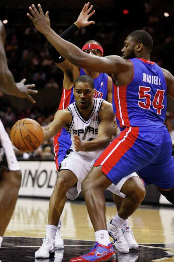 SPURS -- San Antonio Spurs Gary Neal passes the ball as he is surrounded by Detroit Pistons Richard Hamilton and Jason Maxiell in the second half at the AT&T Center, Wednesday, March 9, 2011. The Spurs won 111-104. JERRY LARA/glara@express-news.net Photo: JERRY LARA, San Antonio Express-News / SAN ANTONIO EXPRESS-NEWS (NFS)