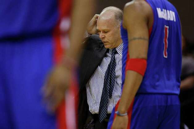 SPURS -- Detroit Pistons Head Coach John Kuester looks dejected as they go on to lose to the San Antonio Spurs 111-104 at the AT&T Center, Wednesday, March 9, 2011. JERRY LARA/glara@express-news.net Photo: JERRY LARA, San Antonio Express-News / SAN ANTONIO EXPRESS-NEWS (NFS)