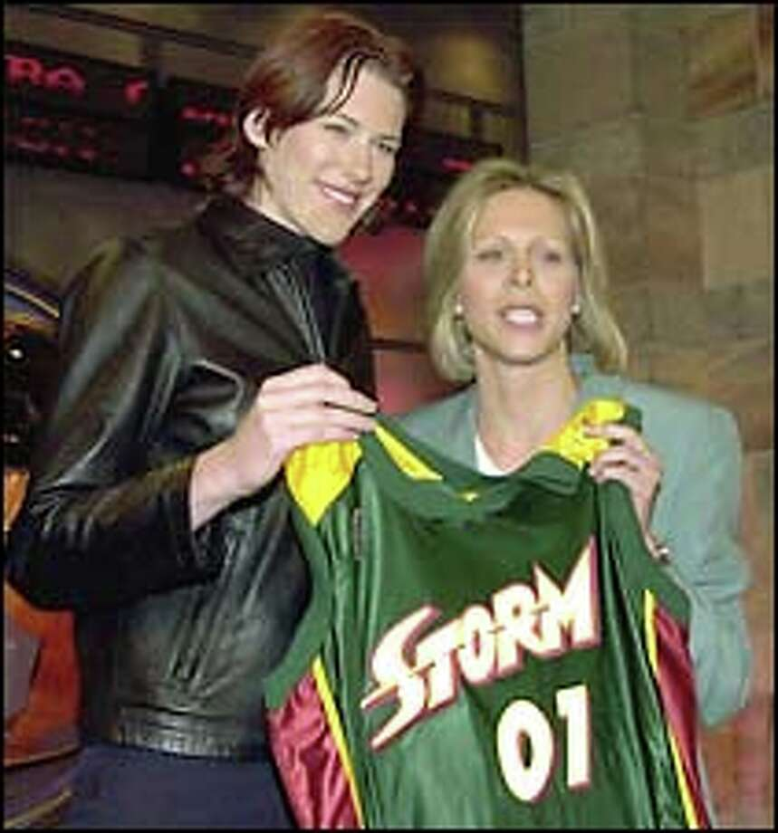 Lauren Jackson and WNBA president Val Ackerman hold up a Storm jersey after the Australian star was selected No. 1. Photo: AP Photo / AP