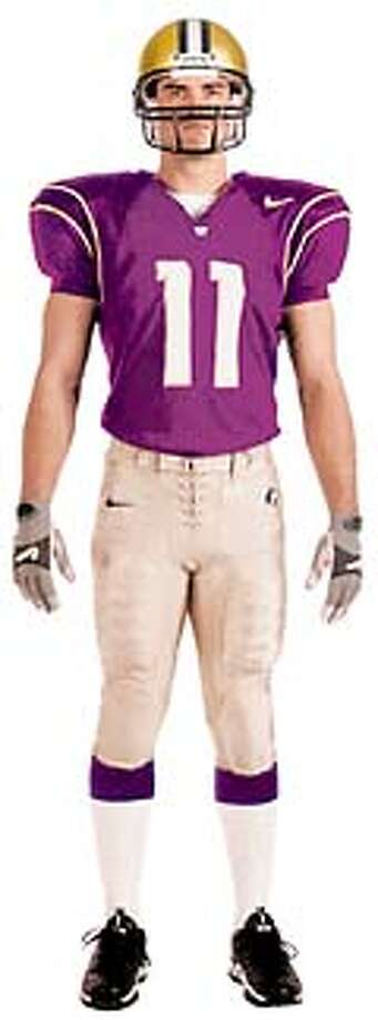 The Huskies' new home uniform, designed by Nike, features a darker jersey than the old one. The gold pants have less of an orange tint.